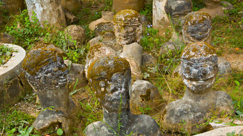 VIENTIANE. LAOS - 13 DEC 2013: Stone statues stick Footage