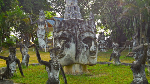 VIENTIANE. LAOS - 13 DEC 2013: Stone statues in Bu Footage