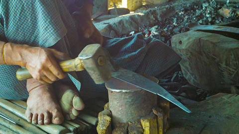Making a large knife in the smithy. Burma Footage