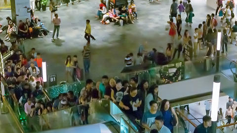 SINGAPORE - CIRCA DEC 2013: Crowds of shoppers in Footage