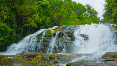 A large waterfall on the river in the forest. Thai Footage