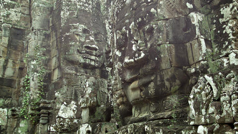 Huge stone faces on the walls of an ancient temple Footage