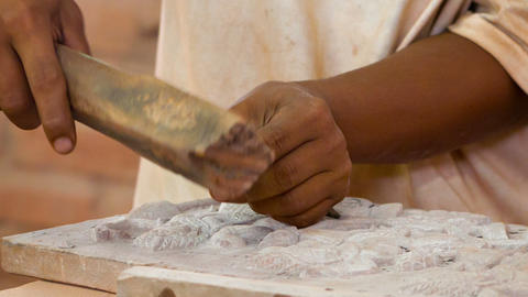 Work on stone carvings. Stone workshop in Cambodia Live Action