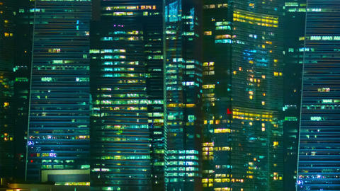 Night windows of office buildings in a big city. S Footage