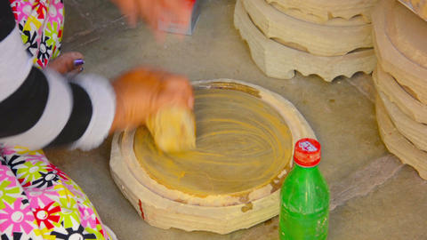 BAGAN. MYANMAR - CIRCA JAN 2014: Rubbing the wood Footage