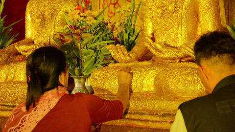 BAGAN. MYANMAR - CIRCA JAN 2014: Visitors of Buddh Footage