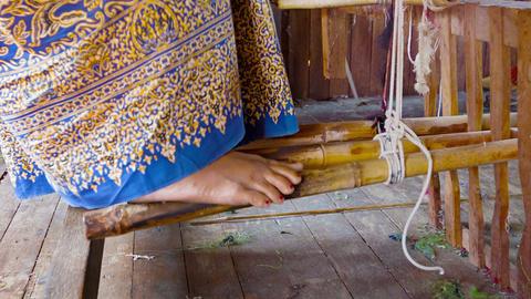 Weaving Factory In Burma. Legs Weaver On Bamboo Pe stock footage