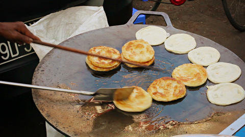 Cooking pancakes on the street for sale. Burma. Ya Footage