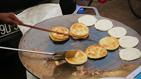 Cooking pancakes on the street for sale. Burma. Ya Footage