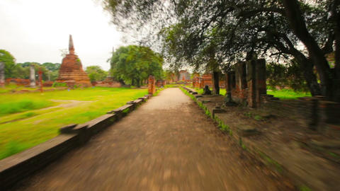 Walking on paths around the ruins of the temples.  Footage