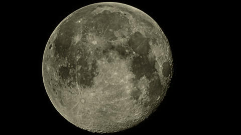 Full moon in the sky with details. close-up Live Action