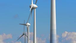 4K wind power turbines rotating against blue sky Footage