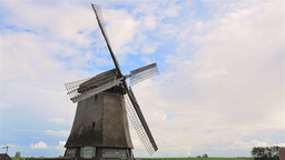 4K traditional Holland windmill rotating, blue sky Footage