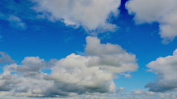 4K cumulus clouds and bright blue sky timelapse Footage