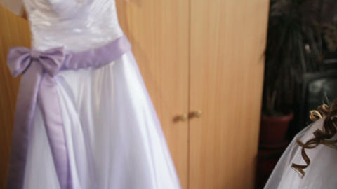 bride doing makeup and wedding dress weighs Footage