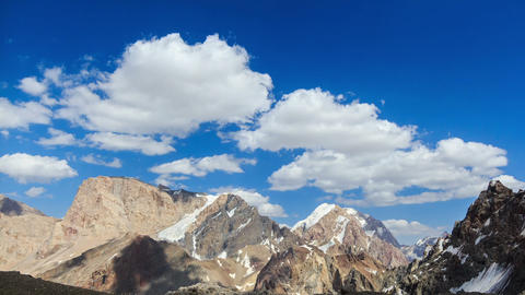 Snowy mountains in clouds. Time Lapse. Pamir, Taji Footage