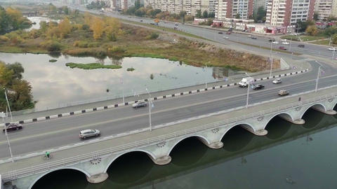 Traffic of vehicles across the bridge. Aerial shot Footage