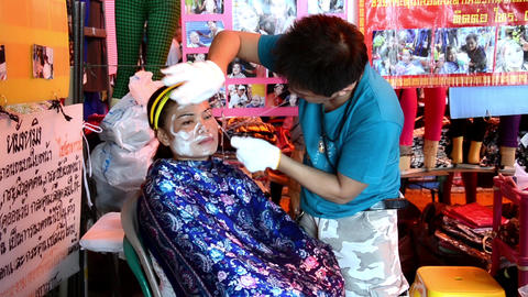 Thailand. Woman And Beautician During Hair Removal stock footage