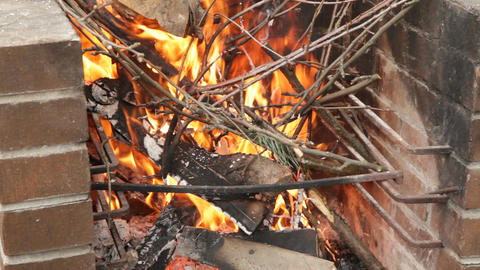 Burning flames in brick outdoors fireplace 1 Footage