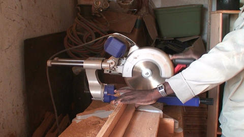 Malawi: african worker cuts wood with electric saw Stock Video Footage