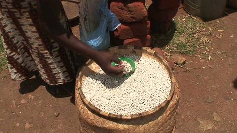 Malawi: african woman sells beans in a market Footage