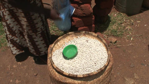 Malawi: african woman sells beans in a market Stock Video Footage