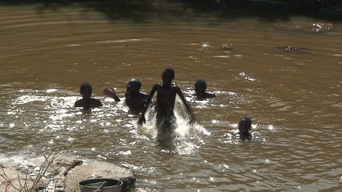 Malawi: african boys play in a water Stock Video Footage