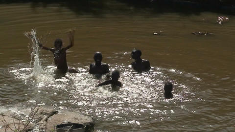 Malawi: african boys play in a water Footage