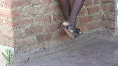 Malawi: moving legs of african boy 2 Footage