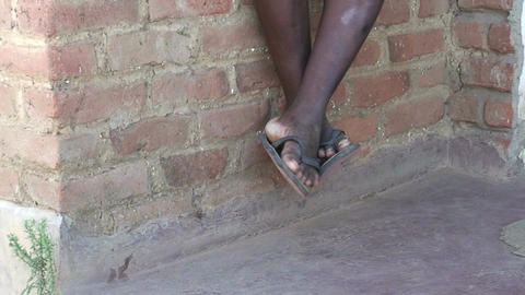 Malawi: moving legs of african boy 2 Stock Video Footage