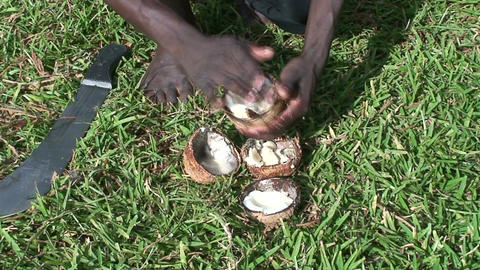 Malawi: african teen cuts coconut 2 Stock Video Footage