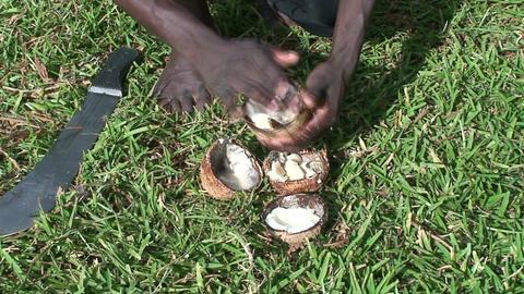 Malawi: african teen cuts coconut 2 Stock Video Footage