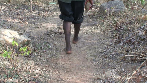 Malawi: african man walks with a stone in a hand Stock Video Footage