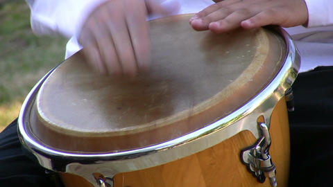 Drumming on conga drum 1