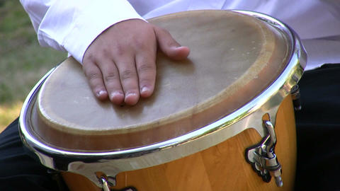 Drumming on conga drum 1 Stock Video Footage