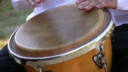 Drumming on conga drum 1 Stock Video Footage