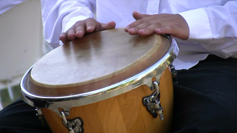 Drumming on conga drum 2 Stock Video Footage