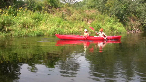 Canoe in a river 1 Stock Video Footage