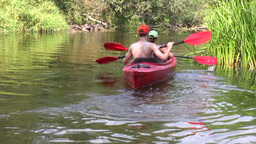 Canoe in a river 2 Stock Video Footage