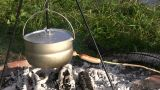 Cooking Sausages In A Campfire 2 stock footage