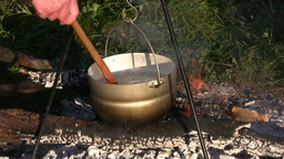 Cooking on open fire 3 Stock Video Footage