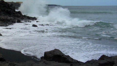 heavy surf wave black lava coast Stock Video Footage
