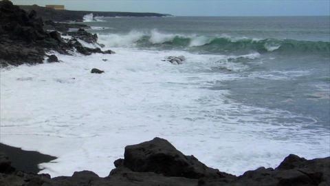 heavy surf wave black lava coast Stock Video Footage