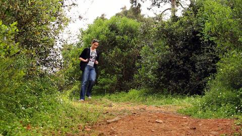 beautiful girl walking on the path 3 Footage