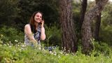 Beautiful Girl Talking On The Phone In Countryside 3 stock footage