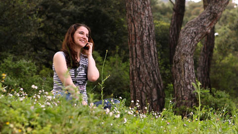 beautiful girl talking on the phone in countryside 3 Footage