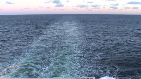 Stream of water waves after cruise ship, view Stock Video Footage