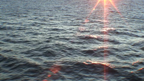 Sunrise and water horizon from moving ship, view Stock Video Footage