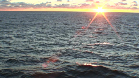 Sunrise and water horizon from moving ship, view Footage