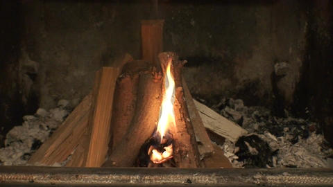 Starting fire in fireplace Stock Video Footage